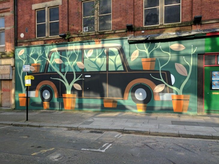 Car mural with pot plants