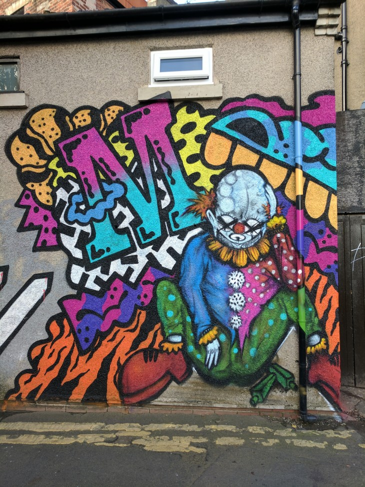 Street art mural of a clown