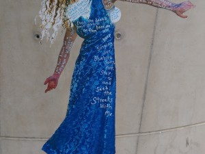 Woman in blue dress covered in poetry