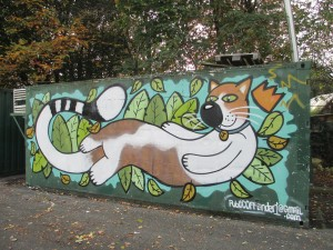Cat painting on side of disused container