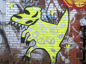 Spray painted yellow dinosaur character