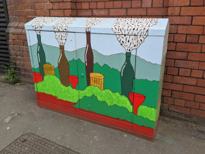 Red Don painted street cabinet